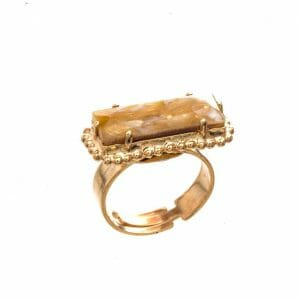 Gold tone ring with glass stone